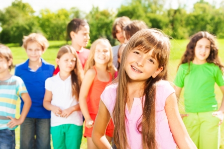 small group: Happy group of people and close portrait one Caucasian girl in red shirt
