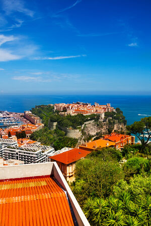 Old city peninsula in Monaco, tiny little country in Mediterranean Europe and Mediterranean sea behind photo