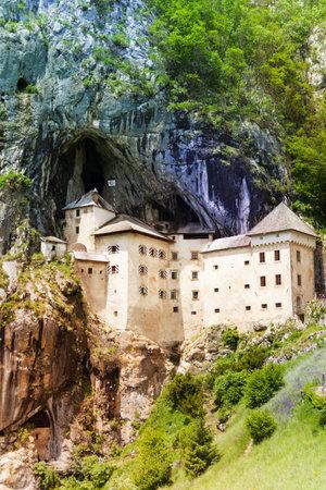 limestone caves: Predjama castle in the mountain, build inside the rock  Famous tourist place in Slovenia  Editorial