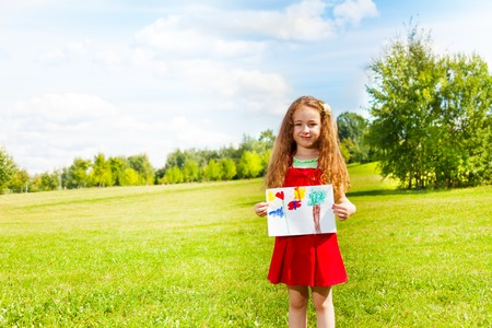 six girls: Portrait of beautiful 6 years old girl standing in the park with painted image on summer day