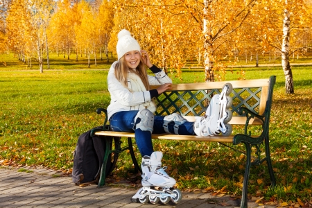 rollerblade: Happy laughing blond teen girl with long hair