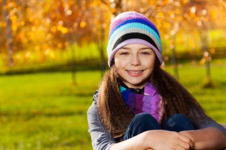 11 years: Close portrait of nice smiling 11 years old girl wearing blue purple hat and scurf Stock Photo