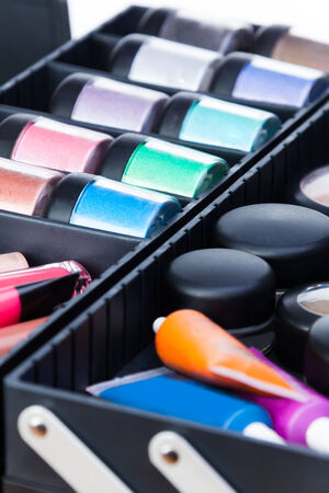 Close-up shoot of tools for makeup artist in beautician case photo