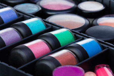 Closeup shoot of many color jars in makeup beautician case photo