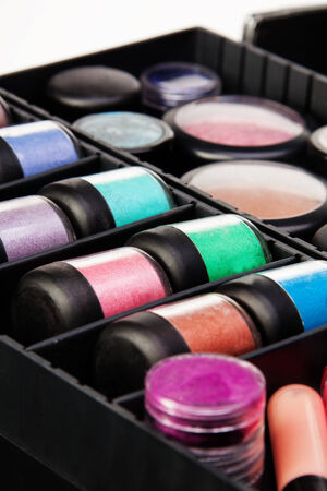 Close shoot of color jars in professional makeup case photo