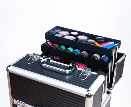 Big professional makeup container with containers tubes lipsticks eyeshades  Stock Photo