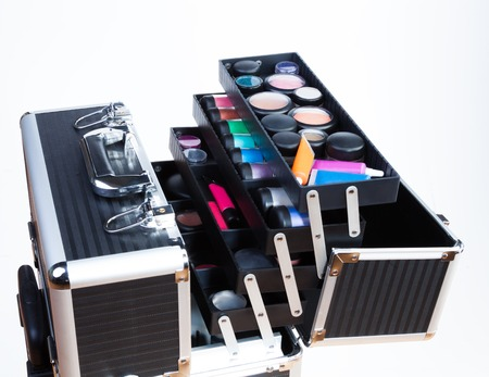 Large professional makeup container with containers tubes lipsticks eyeshades  Stock Photo