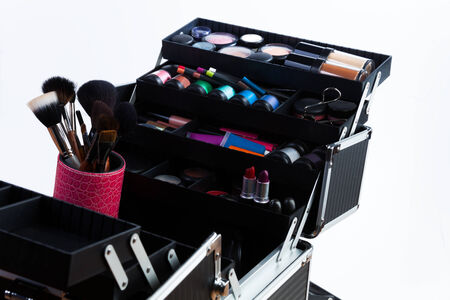 Large professional makeup container with containers tubes lipsticks eyeshades and makeup brushes photo