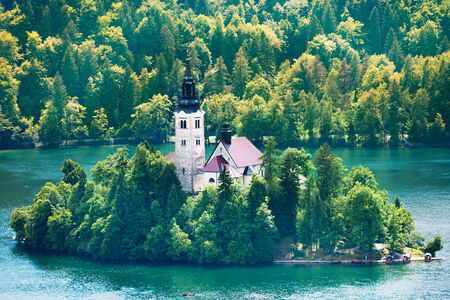bled: Close shoot of the church on the small island in the middle of the Bled lake, symbol of Slovenia Stock Photo