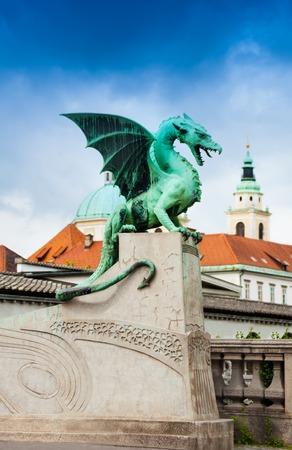 Ljubljana downtown and statue on the Dragon Zmajski most bridge  photo