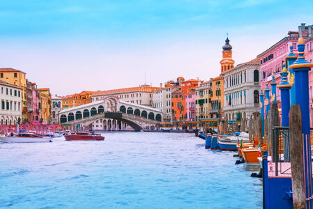 rialto bridge: Rialto Bridge, boats, gondolas and color buildings of Venice in itally Stock Photo