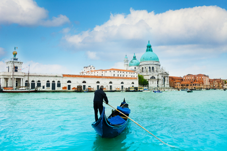 gondola: Santa Maria della Salute Basilica in Venice with gondola and gondolier in central Venice, Italy