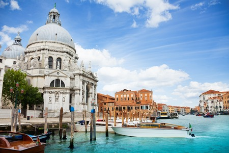 embark: Santa Maria della Salute Basilica in Venice with boats embarked