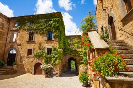lazio: Main gates and buildings to Bagnoregio town, Lazio, Italy  Stock Photo