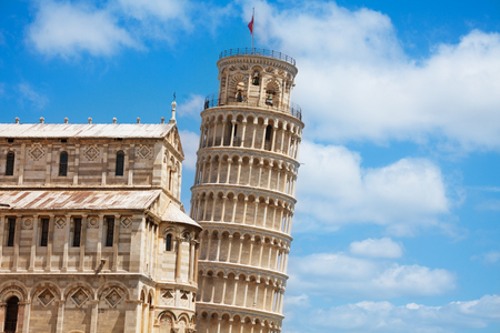 leaning tower of pisa: Leaning Pisa tower and part of cathedral with sky clouds as background Stock Photo
