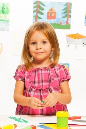 gluing: Little happy little young girl gluing on creative art class
