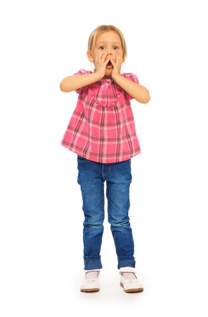 full height: Full height portrait shocked little blond 4 years old girl holding face with hands Stock Photo