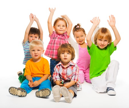 small group: Many happy kids 3-4 years old sitting isolate on white