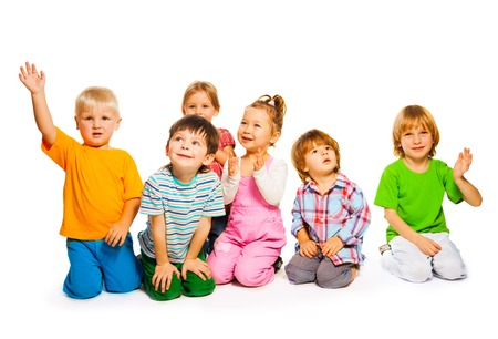 five years old: Large group of happy little kids isolated on white
