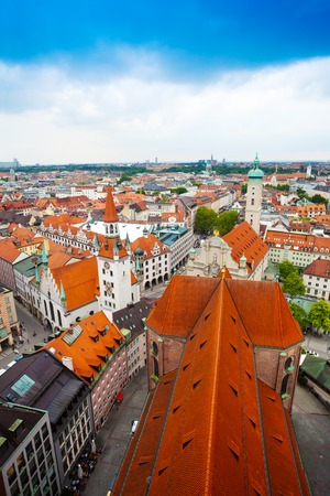 city centre view of Old Town Hall, with red roofs and skyline in Munich, Bavaria, Germany photo