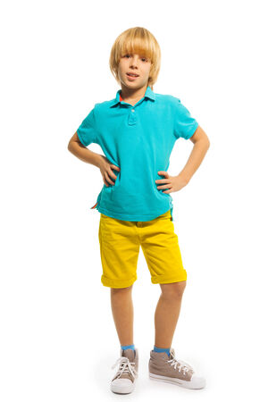 yellow shirt: Happy 8 years old boy in blue shirt and yellow pants