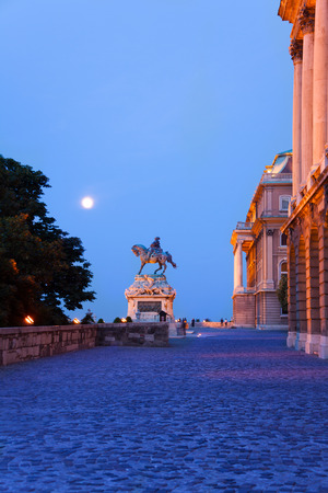 Monument of horseman near Buda Castle in evening with the moon light in Budapest, Hungary photo