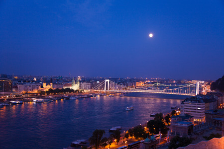 megyeri: Megyeri Bridge with the moon light on Danube river with reflections at night in Budapest, Hungary Stock Photo
