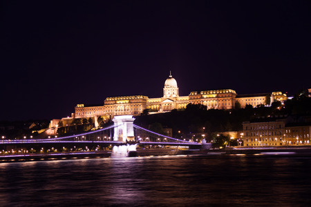 Buda Castle with Chain bridge on Danube river at night in Budapest, Hungary