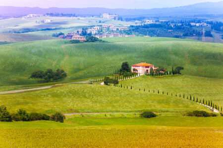 footway: Lonely house standing on the field in Tuscany landscape, Italy