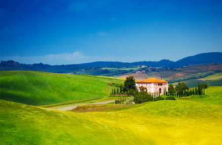 footway: Hills and lonely house in Tuscany landscape, Italy