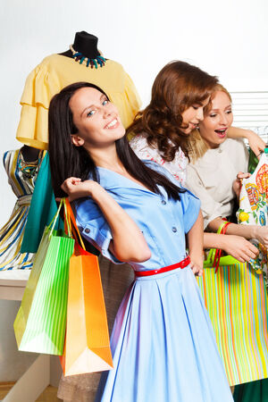 Funny beautiful women shopping together in the shopping mall photo