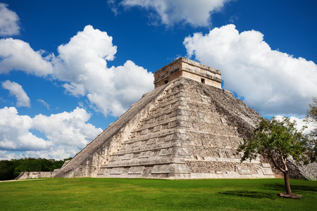 Beautiful view of Chichen Itza monument, Mexico and one tree standing nearby photo