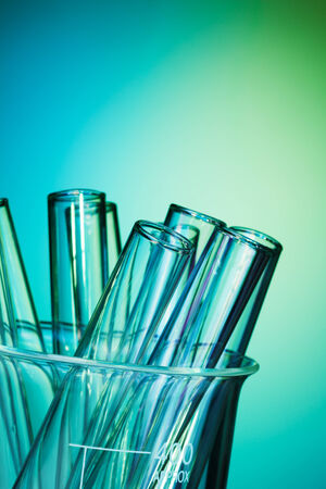test glass: Glass test tubes together on the blue green background