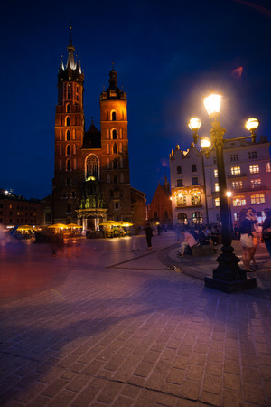 Beautiful Saint Marys Basilica and Rynek Glowny (main square) at night in Krakow, Poland photo