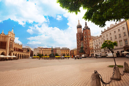 Beautiful Saint Marys Basilica and Rynek Glowny (main square) Krakow, Poland photo
