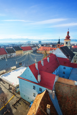 Rows of red roofs near Piata Mare (Large square) in Sibiu, Romania photo