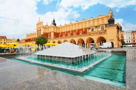 cracow: Cloth Hall on Rynek Glowny (main square) and fountain in Krakow, Poland