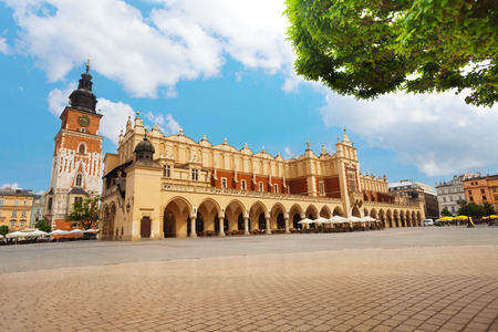 Town Hall Tower (Wieza ratuszowa w Krakowie) and Cloth Hall on  Rynek Glowny (main square) in Krakow, Poland Stock Photo
