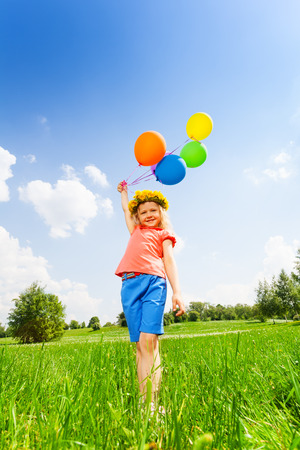 circlet: Small girl with colorful balloons wearing circlet in summer