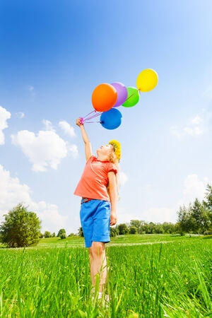 circlet: Looking girl with colorful balloons wearing flower circlet in summer