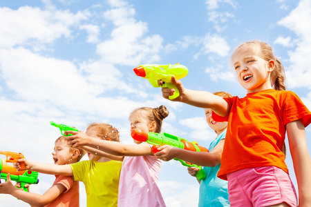 water gun: Five kids play with water guns