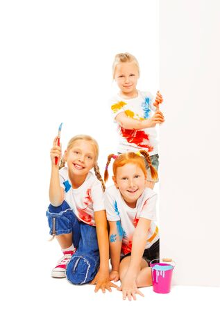 Three little girls in painted shirts smile photo