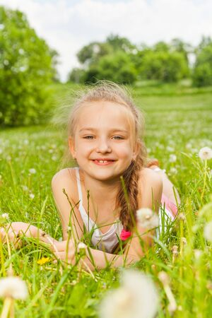 Beautiful girl laying on a meadow photo