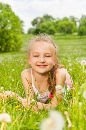 Beautiful girl laying on a meadow photo