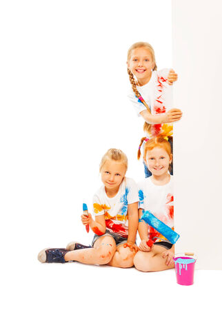 Three kids in painted shirts photo