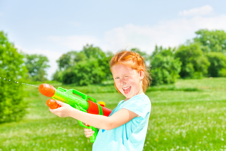 Nice girl with a water gun photo
