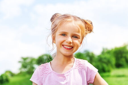 Beautiful little girl smiles at camera photo