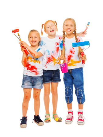 Three smiling girls with brushes photo