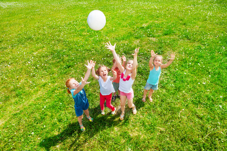 children at play: Kids playing ball on a meadow