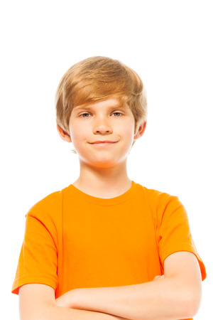 Portrait of a boy in orange shirt on white